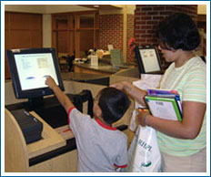 Patrons using self-checkout machine
